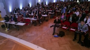 A photo taken at a conference with Google Glass