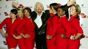 Sir Richard Branson with Virgin Atlantic air stewardesses