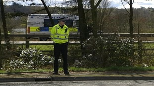 Police officer directs traffic on the M9 yesterday
