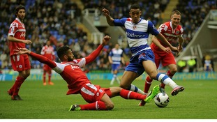 Reading's Nick Blackman (right) is tackled by Queens Park Rangers' Armand Traore.