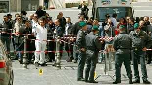 Italian police patrol the area where two officers were shot and wounded outside the Prime Minister's Office.
