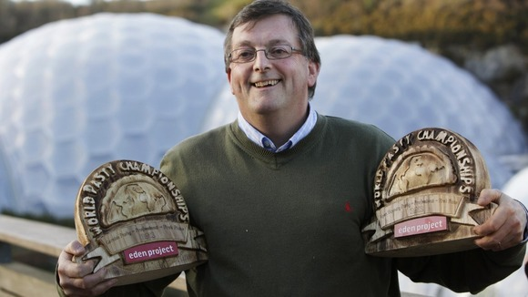Graham Cornish showing of his World Pasty Championship trophies at the Eden Project