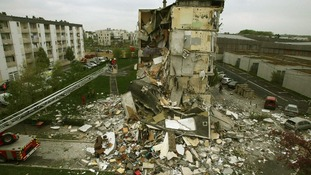 Rescue forces surround the rubble of a collapsed residential building in Reims, France.