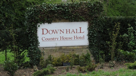 The entry sign to the hotel