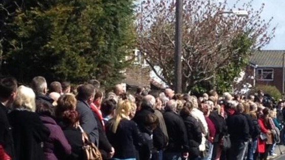 Crowds line the streets close to the church in Formby to pay their respects to Anne Wiliams.