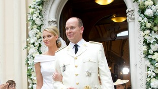 Prince Albert II of Monaco and Princess Charlene are pictured as they leave the Church Sainte Devote in Monte-Carlo.