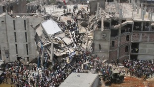 Crowds gather at the collapsed Rana Plaza building last Wednesday