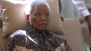 Nelson Mandela pictured for the first time since he was discharged from hospital.