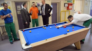 Governor Gary Monaghan (second left) and Justice Secretary Chris Grayling (second right) speak with inmates