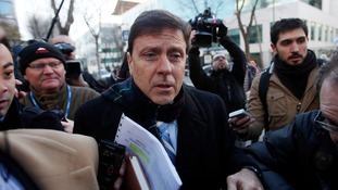 Spanish doctor Eufemiano Fuentes is surrounded by media as he enters a courthouse in Madrid