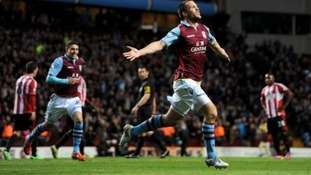 Aston Villa's Ron Vlaar celebrates scoring his side's first goal of the game