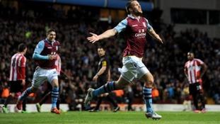Aston Villa's Ron Vlaar celebrates scoring his side's first goal of the game