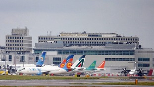 Planes on the runway at Gatwick Airport