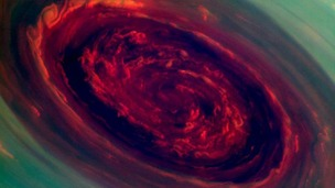 Saturn's north polar storm spinning vortex resembles a giant ros