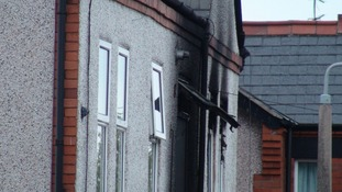 The fire damaged flat in Prestatyn, North Wales, where the family members died.