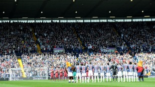 West Bromwich Albion and Newcastle United players take part in a minutes applause for Dave Matthews