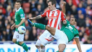 Stoke City's Glen Whelan and Norwich City's Elliott Bennett (right) battle for the ball