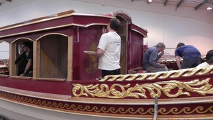 Craftsmen work on the boat.