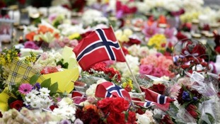 Norwegian flag placed amongst floral tributes outside Oslo Cathedral in July 2011