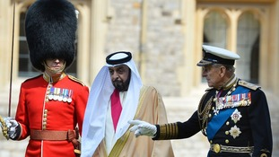 Sheikh Khalifa bin Zayed Al Nahyan inspects members of the 1st Battalion Welsh Guards with the Duke of Edinburgh
