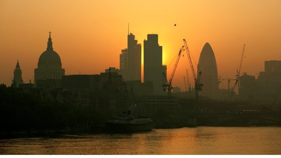The sun rises over London's financial district