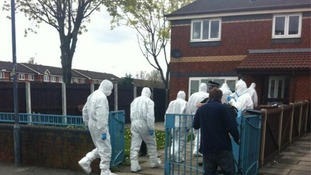 Specialist forensic officers enter the property.