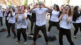 Members of the flash-mob perform outside Defra headquarters today