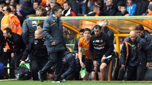 Wolves manager Dean Saunders is dejected at the final whistle after losing to Burnley