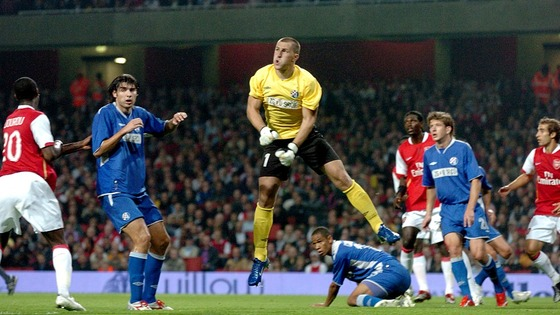Ivan Turina, playing for Dinamo Zagreb, clears the ball against Arsenal in a UEFA Champions League third round qualifying match in 2006.