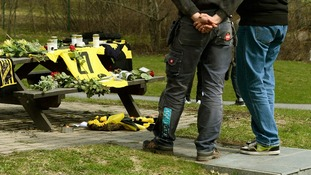 An AIK jersey and flowers lay outside the training ground in memory of the goalkeeper.