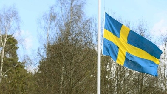 A Swedish flag at half-mast outside the training ground of Turina's club, AIK Solna in Stockholm.