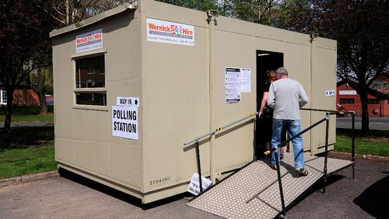 A man walks to a portable polling station in Portia Close, Nuneaton, as voters go to the polls in local elections.