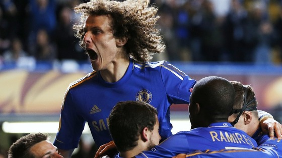Chelsea's David Luiz celebrates with team-mates after the goal by Victor Moses