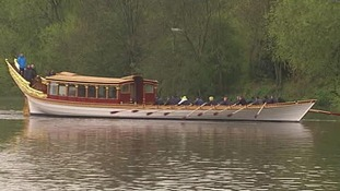 The royal row barge takes to the Thames.