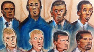 Court artist's impression of the eight defendants