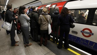 Passengers wait to get on the tube