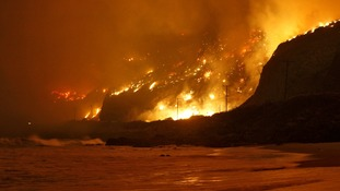 The so-called Springs Fire rages along the coast of California.