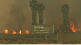 The fire has spread to the Point Mugu Naval Base in California.