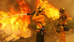 Firefighters battle the so-called Springs Fire at Point Mugu State Park.