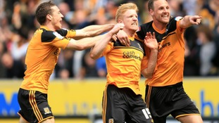 Hull City's Paul McShane celebrates scoring the second goal with teammate David Meyler (r).