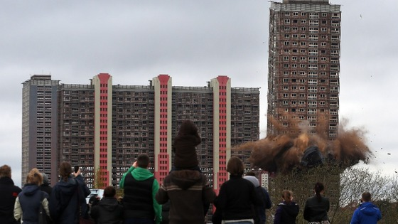 Glasgow's Red Road flats being demolished by use of controlled explosives.