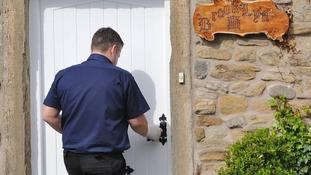 Police outside doorway