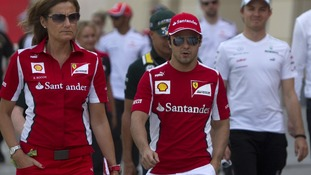 Ferrari Formula One driver Felipe Massa of Brazil walks in the pits
