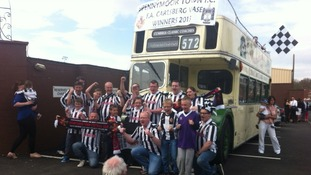 Fans get a quick picture before bus sets off.