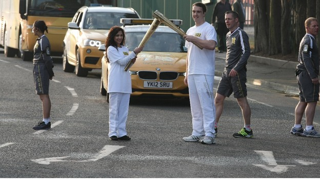 Jasmine Vanmali and Samuel Rowbotham holding the torch