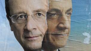 Official campaign posters Socialist Party winner Francois Hollande and his rival Nicolas Sarkozy