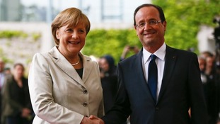 The German Chancellor Angela Merkel with President Hollande