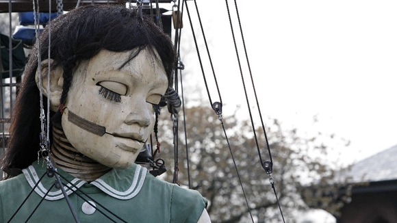 The Little Girl Giant, a giant marionette created by experts Royal De Luxe.