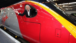 A union has accused Sir Richard Branson of sourcing train uniforms from 'Del Boy' Trotter