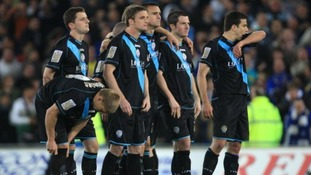 Leicester City players appear dejected after being knocked out of the play offs after the final whistle by Cardiff City